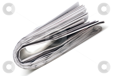 Closeup of a newspaper stock photo, Tilted view of a folded newspaper by Vince Clements