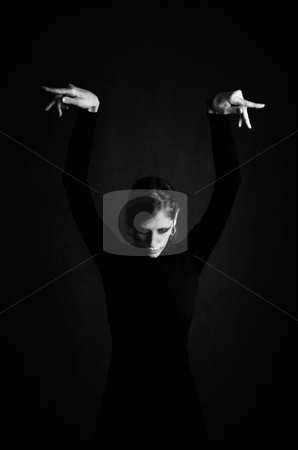 Pretty Woman in a Black Dress stock photo, Pretty Woman in a Stretchy Knit Black Dress with Hands Over Her Head by Scott Griessel