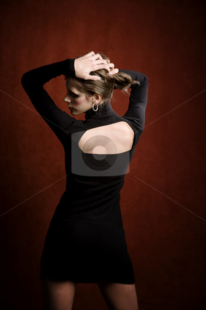 Pretty Woman in a Black Dress stock photo, Pretty Woman in a Stretchy Knit Black Dress from Behind by Scott Griessel