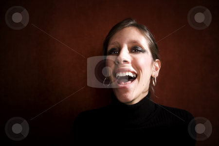 Pretty Woman in a Black Dress stock photo, Pretty Woman Laughing in a Black Turtleneck by Scott Griessel