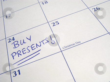 Buy presents written on a calendar on the 24th December, Christmas Eve. stock photo, Buy presents written on a calendar on the 24th December, Christmas Eve. by Stephen Rees