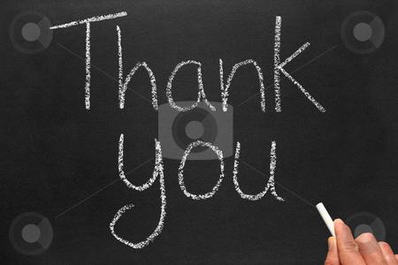 Writing thank you on a blackboard. stock photo, Writing thank you on a blackboard. by Stephen Rees