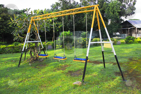 Swing stock photo, Three seat swing in a childrens playground by Jonas Marcos San Luis