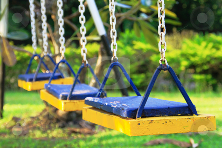 Swing 2 stock photo, Three seat swing in a childrens playground by Jonas Marcos San Luis