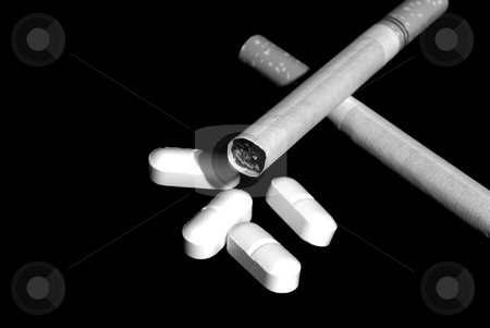 Smokes and pills stock photo, Cigarettes and pills by John Teeter
