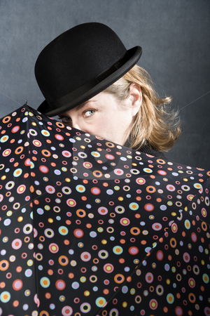 Woman in a bowler hat with umbrella stock photo,  by Scott Griessel