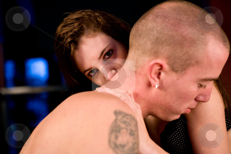 Girlfriend kissing her boyfriens neck while looking at you stock photo, Girlfriend and boyfriend being passionate with each other by Frenk and Danielle Kaufmann