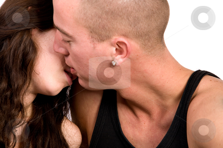 Young couple who are in love and kissing stock photo, Girlfriend and boyfriend being passionate with each other by Frenk and Danielle Kaufmann