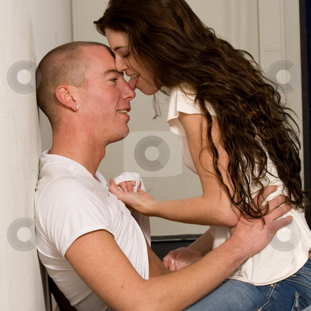 Young couple who are in love a lick on his nose stock photo, Girlfriend and boyfriend being passionate with each other by Frenk and Danielle Kaufmann