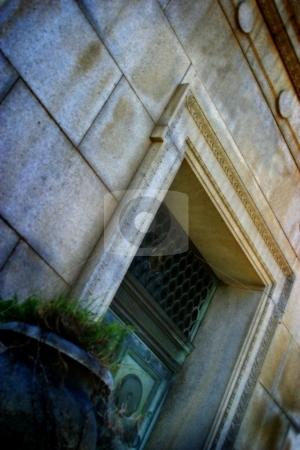 The Last Door stock photo, Door to an old mausoleum at a cemetery. by Henrik Lehnerer
