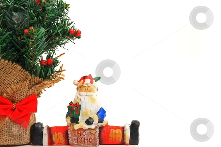 Merry Christmas stock photo, Christmas tree and santa ornamints by Jack Schiffer