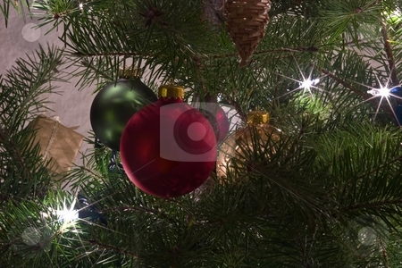 Christmas ornaments stock photo, Christmas ornaments are decorations (usually made of glass, metal, wood or ceramics) that are used to festoon a Christmas tree. by Mariusz Jurgielewicz