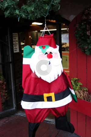 Santa in the window stock photo, A santa hanging in the window by Tim Markley