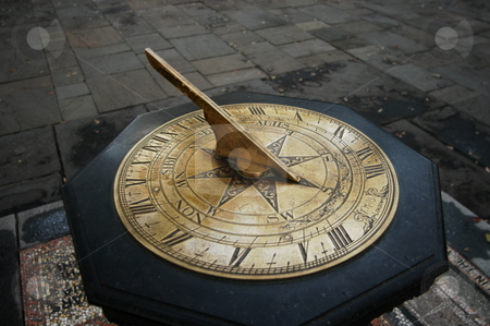 Old sun dial stock photo, Old sun dial in a park setting by Tim Markley