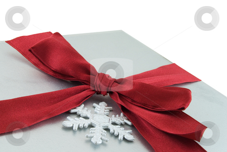 Christmas Present stock photo, Silver gift box with red bow and snowflake isolated on white by Brent Hathaway