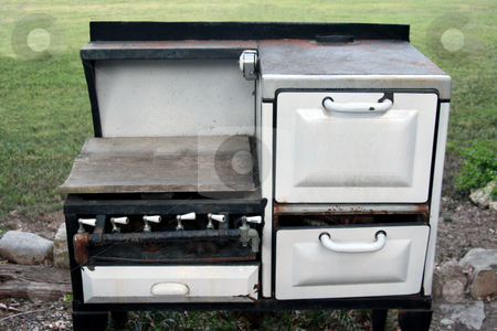 Old Stove stock photo, An old rusting iron stove sitting outside by Kevin Tietz