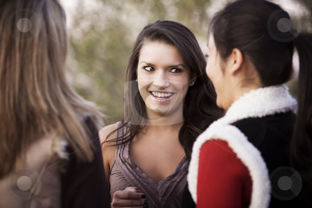 Three Friends stock photo, Portrait of three female friends focusing on Hispanic woman by Scott Griessel