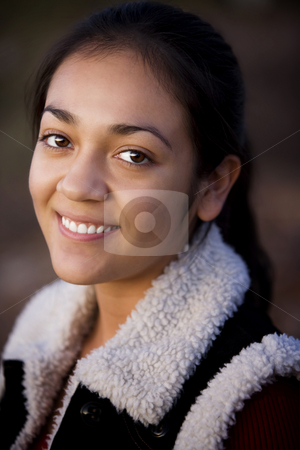 Pretty Hispanic Teenager stock photo, Portrait of pretty Hispanic teenager in outdoor setting by Scott Griessel