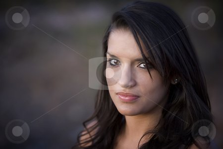 Pretty Hispanic Woman stock photo, Closeup portrait of a pretty Hispanic woman outdoors by Scott Griessel
