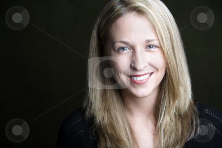Pretty Blonde Woman stock photo, Portrait of pretty blonde woman on a dark background by Scott Griessel