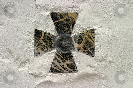 Cross stock photo, Black marble cross on a whit wall. by Henrik Lehnerer