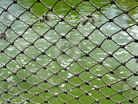 Rope Net stock photo, A pattern of a net alongside a lake. by Lucy Clark