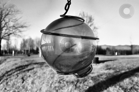 Hanging balll stock photo, A large hanging ball shown in black and white by Tim Markley