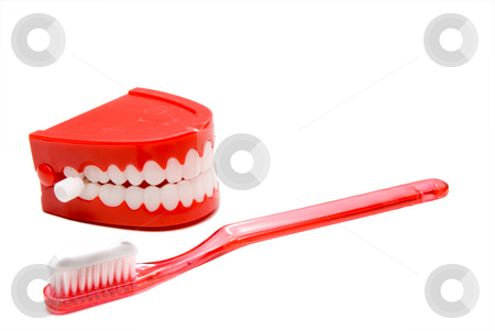 Dental Hygiene stock photo, A toothbrush and a set of chattering teeth. by Robert Byron