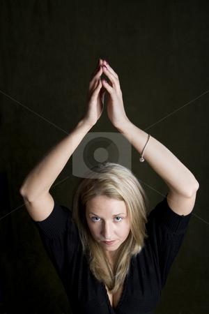Pretty blonde woman with her hands above her head stock photo, Pretty blonde woman holding her hands above her head by Scott Griessel