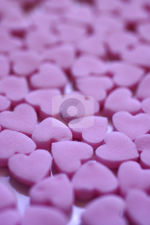 A Hearty Plate stock photo, A macro shot full of tiny hearts, cut by hand from some freshly rolled pink icing, ready for decorating Birthday cup-cakes. by Tim Green