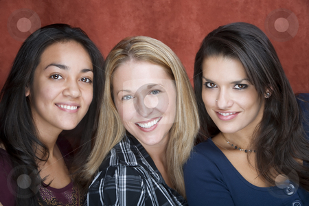Three Smiling Women stock photo, Three pretty women smiling in a studio setting by Scott Griessel