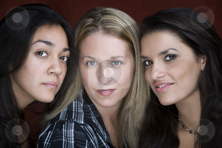 Three Smiling Women stock photo, Three smiling young women in a studio setting by Scott Griessel