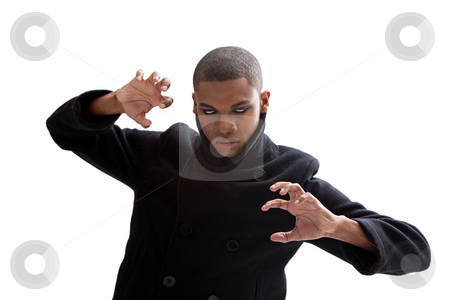 Zombie ghoul stock photo, African man with smokey white eyes, strong expression and black coat, isolated by Paul Hakimata