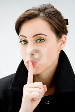 Blue eyed beauty stock photo, Face of a beautiful blue eyed brunette saying shhhhh, isolated by Paul Hakimata