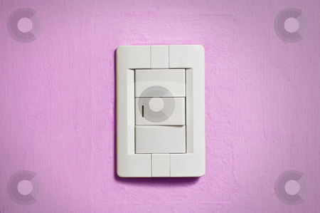 White light switch. stock photo, White light switch on old pink wall. by Pablo Caridad