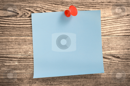 Blue paper note  on wood, clipping path. stock photo, Blue paper note with thumbtack on wooden surface, clipping path. by Pablo Caridad