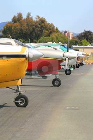 Row of Airplanes stock photo, Close up of a row of airplanes. by Michael Felix