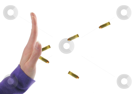 Hand stopping bullets stock photo, Hand stopping bullets on a white background by John Teeter
