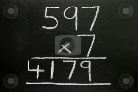 A basic multiplication sum on a blackboard. stock photo, A basic multiplication sum on a blackboard. by Stephen Rees