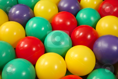 Lots of colorful plastic play balls. stock photo, Lots of colorful plastic play balls. by Stephen Rees