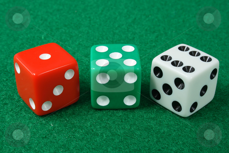 Three dice on a green cloth background. stock photo, Three dice on a green cloth background. by Stephen Rees