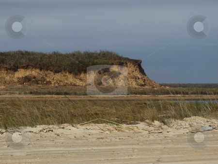 Eroded Sand Dune stock photo, Sand Dune eroded due to Hurricane.  The outcropping is what is left of a massive sand dune. by Marburg