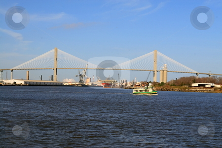 Talmadge Memorial Bridge stock photo, Ferry boat crossing the Savannah river with the Talmadge memorial bridge by Jack Schiffer
