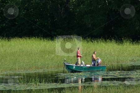 Fishing escape stock photo, Two fisherman try their luck fishing a Minnesota lake on a quiet, sunny afternoon. by Dennis Thomsen