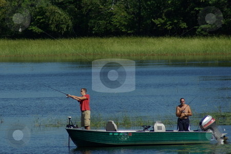 Fishing escape stock photo, Two fisherman try their luck fishing a Minnesota lake on a quiet summer afternoon. by Dennis Thomsen