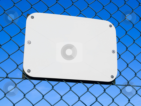 Blank white sign on a chain link fence. stock photo, Blank white sign on a chain link fence. by Stephen Rees