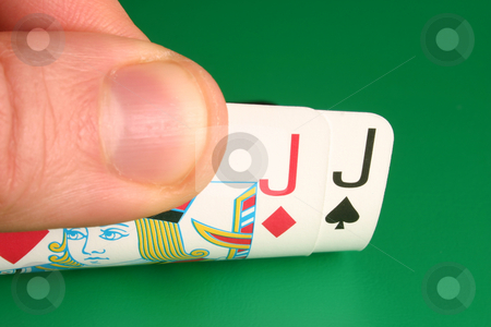 Looking at pocket Jacks hooks during a poker game stock photo, Looking at pocket Jacks (hooks) during a poker game by Stephen Rees