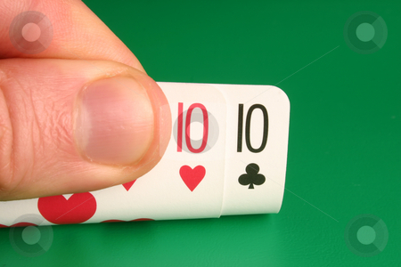 Looking at pocket tens during a poker game stock photo, Looking at pocket tens during a poker game by Stephen Rees