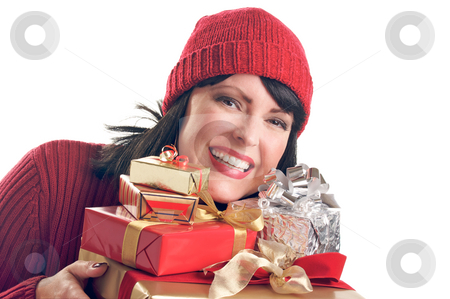 Attractive Woman Holds Gifts stock photo, Attractive Woman Holds Holiday Gift Isolated on a White Background. by Andy Dean