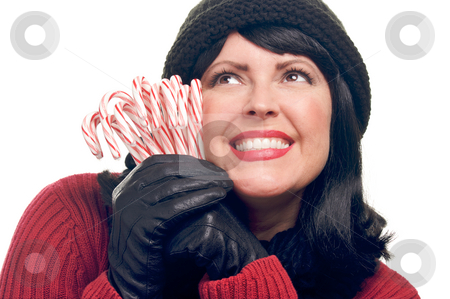 Attractive Woman Holds Gift stock photo, Attractive Woman Holds Holiday Gift Isolated on a White Background. by Andy Dean